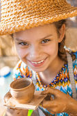 Little girl with pot — Foto Stock