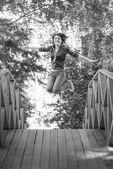 Jump girl on summer bridge — Stock Photo