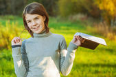 Portrait of girl with book — Stock Photo