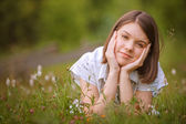Teen girl lying on grass — Stock Photo