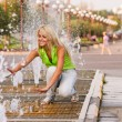 Girl about fountain — Stock Photo #5494459