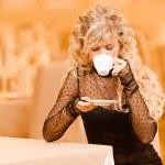 Young woman drinks tea. — Stock Photo #5556609