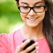 Woman reads text message on cellular telephone — Stock Photo #5858464