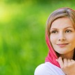 Portrait of young smiling woman wearing kerchief — Stock Photo #6145611