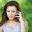 Portrait of serious girl speaking on mobile telephone — Stock Photo #6554564