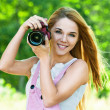 Beautiful woman holds camera — Stock Photo #6890766