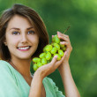 Beautiful woman holding grapes — Stock Photo #6905209
