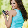 Young woman working with smartphone — Stock Photo #8483750