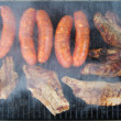 Pork ribs and sausages on the grill — Stock Photo