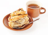 Apple and pear pie with a cup of tea — Stock Photo