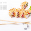 Sushi roll with sesame, sweet pepper, cucumber and wasabi — Stock Photo #14257669