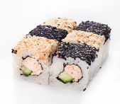 Sushi roll with fish and cucumber in sesame — Stock Photo