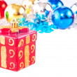 New year background with colorful decoration balls and gift box — Stockfoto