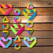 Background with color paper hearts over wood background — 图库矢量图片