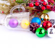Christmas background with cones, color balls and glass — Stock Photo