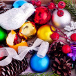 Christmas background with cones, color balls and berries — Стоковая фотография