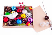Christmas decorations - cones, balls, berries and paper — Stock Photo