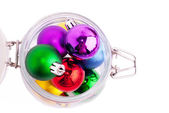 New Year bright color decoration ball in glass can — Stock Photo