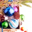 Christmas background with cones, color balls and berries — Stok fotoğraf