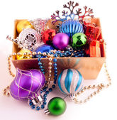 Christmas background with basket full of color balls — Stock Photo