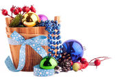 Christmas background with wood bucket, cones, color balls and be — Stock Photo