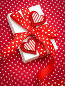 White gift box with red ribbon — Stok fotoğraf