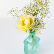 Small bouquet in blue vase - Stock Photo