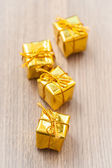 Decorative gifts on wooden background — Photo