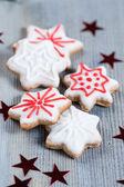 Gingerbread cookies over wooden background — ストック写真