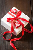 Gift box with red ribbon — Stok fotoğraf