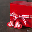 Stock Photo: Gift box with red ribbon