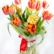 Bouquet of yellow hyacinths and red tulips — Stock Photo