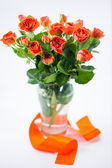 Orange roses in vase — Stock Photo