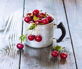 Cherry in a aluminum cup — Stock Photo