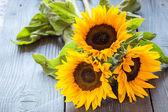 Sunflowers on table — Stock Photo