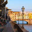 "Bank near Ponte Vecchio (""Old Bridge"") at evening. Florence, Tuscany, Italy. — Stock Photo #29125669"