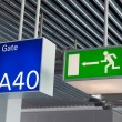 Stock Photo: Green emergency exit sign,and blue gate sign in airport