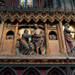 Scenes from a religious life on a wall inside Notre-Dame of Paris — Stock Photo #29654463