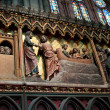 Scenes from a religious life on a wall inside Notre-Dame of Paris — Stock Photo #29654467
