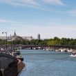 Seine river with tourists ship in Paris, France. Every day thousands of tourists use this ships to observe the Paris — Stock Photo
