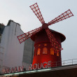 Stock Photo: Moulin Rouge is famous cabaret built in 1889 and is located in Paris red-light district of Pigalle.