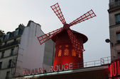 Moulin Rouge is a famous cabaret built in 1889 and is located in the Paris red-light district of Pigalle. — Stock Photo