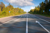 Road in forest of Central Russia — Stock Photo