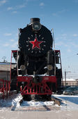 Monument of old steam locomotive in Abakan — Stock Photo