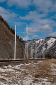Road and electricity line from Sayano-Shushenskaya hydroelectric power station — Stock Photo