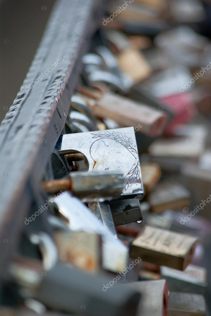 Photo of locks on a bridge for in love  Stock Photo #12246901