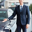Royalty-Free Stock Photo: Seller near cars
