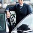 Businessman near cars — Stock Photo