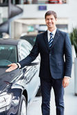 Seller near cars — Stock Photo