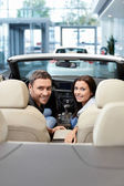Couple in a cabriolet — Stock Photo